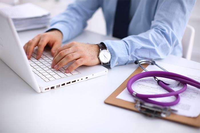 doctor using laptop for nurse recruitment
