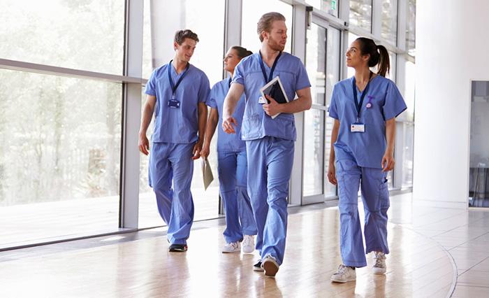 group of nurses walking down corridor