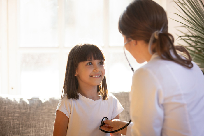 private duty nurse talking with young patient
