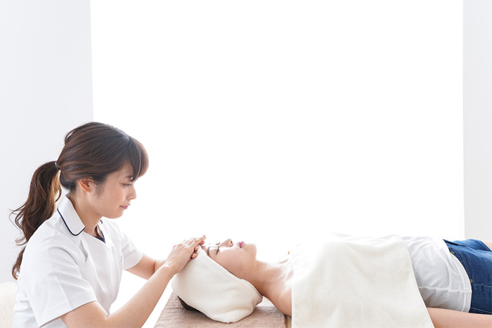 esthetician working with client at beauty salon