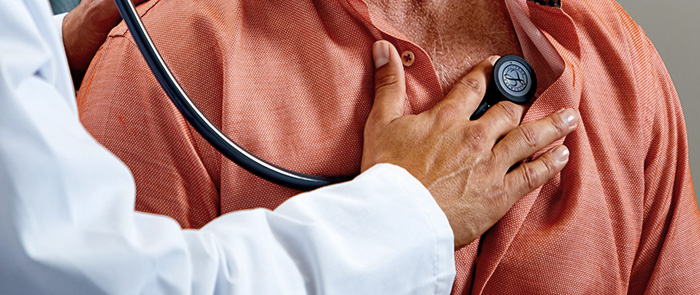 Doctor using Littmann Cardiology IV Stethoscope on patient