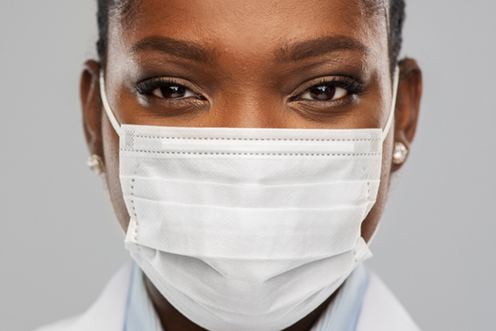 close up of masked healthcare worker